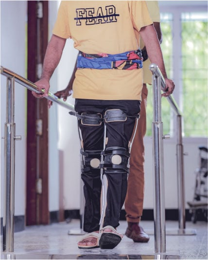 Patient trying to walk with the help of nurse in the rehab centre